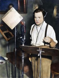 ORSON WELLES (1915-1985). /nAmerican director, producer, screenwriter, and actor. Shown broadcasting his famous adaptation of H.G. Wells' novel 'The War of the Worlds,' 30 October 1938. Oil over a photograph.